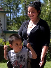 Jennifer Rodriguez, 19, pushes her son, Anthony Villarreal, 3, on the swings at the Teen Parent Program, part of the Early College High School, at Chemeketa Community College in Salem on Thursday, May 7.