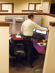 Mark Conrad of Webster prepares for a meeting at the APFS Wealth Management Inc. offices in Linden Oaks.