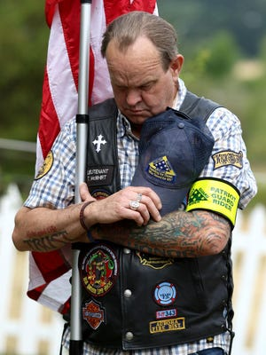 Thomas McWhirt, with the Patriot Guard Riders, during an opening prayer at a dedication for a Fallen Hero Memorial Highway sign, in memory of Army Cpl. Kory D. Wiens, 20, on Saturday, July 11, 2015, south of Dallas.