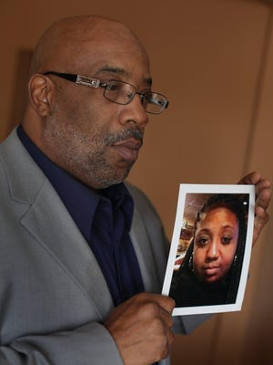Left: Chris Samuel holds a photo of his daughter Christina Samuel, 22, who was killed Dec. 24. right: Jennifer Stalker stands next to a photo of daughters Paige, 16, foreground, who was killed Dec. 22, and Madison, 21.