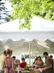 Guests help themselves to food during the Sunday Dinner at the Farm series at Kimball Brook Farm in North Ferrisburgh.