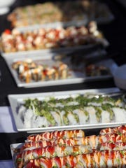 Plates of sushi are displayed in front of Takanami on Wednesday, Aug. 27, 2014.