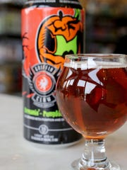 Screamin' Pumpkin by Griffin Claw Brewing Company. Pumpkin beers photographed on location at 8 Degrees Plato Beer Company on Cass Avenue in Detroit, Tuesday, October 2, 2015.