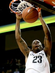 Oregon's Elgin Cook (23) makes a dunk in the Northwest Christian vs. Oregon men's exhibition basketball game at the Matthew Knight Arena in Eugene on Tuesday, Nov. 3, 2015.