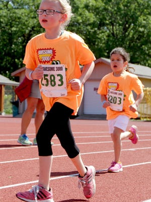 Girls run during last year's Awesome 3000 at McCulloch Stadium at Bush's Pasture Park. This year's event is May 7.