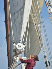 Appledore IV crew member Jonathan Drolet of Chicago secures lines during its voyage to Green Bay on Thursday.