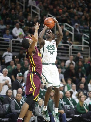Michigan State guard Eron Harris scores against Minnesota guard Dupree McBrayer during the first half of MSU's 65-47 win Wednesday at Breslin Center.