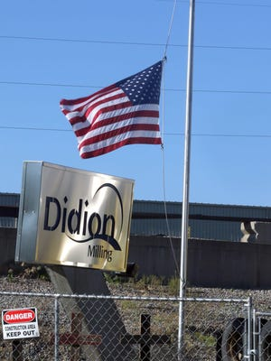 The flag flying at half mast in front of the rubble left from a May 31 explosion at a corn mill plant at the Didion Milling complex in Cambria has been raised to full staff after the last person injured in the blast was released from the hospital. Five workers died as a result of the explosion.