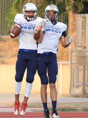 West QB Andre Aguilar celebrates his TD with teammate Dominic Sanquintin during the East-West Tulare-Kings Counties All-Star Football Game at Groppetti Automotive Visalia Community Stadium.