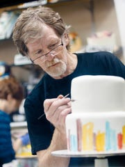 Jack Phillips, owner of Masterpiece Cakeshop in Lakewood, Colo., decorates a cake for a client on Sept. 21, 2017. Phillips refused to bake a cake for a same-sex couple in 2012, and is now awaiting a U.S. Supreme Court ruling after the Colorado Civil Rights Commission's ruling that he bake cakes for same-sex couples or not bake wedding cakes altogether.