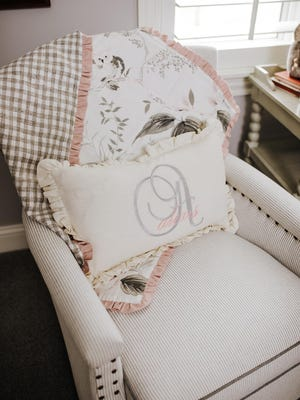 Pick an interesting mix of textiles for your bedding and pillows, being sure to incorporate touchable fabrics and trims like chenille stripes, pom-poms and rick rack. For fun, personalize a pillow or two with your child's name or monogram.