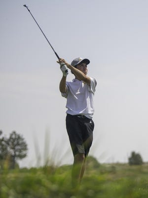 East High School's Evan Smith watches his ball after teeing off on the 12th hole during the Centennial Invitational at Walking Stick Golf Course last Wednesday.