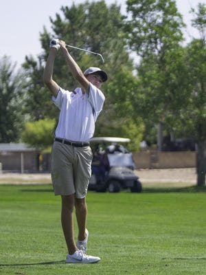 East High School's Evan Smith hits his second shot from the fairway on the 12th hole during the Class 4A Region 1 boys golf tournament at  Desert Hawk Golf Course in 2020. [Chieftain photo/Zachary Allen]