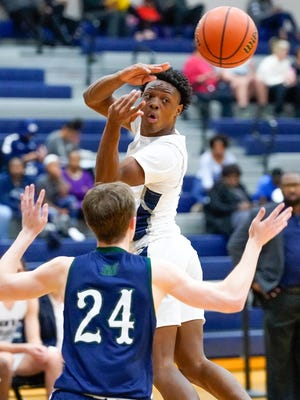 Hendrickson point guard Jaden Williams passes the ball against McNeil last season. Williams has pledged to Tulane to play both football and basketball.