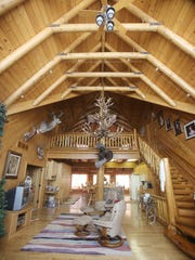 This is a log cabin in Brown City with high ceilings.