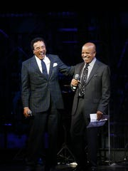 "Smokey Robinson and Berry Gordy Jr. share a laugh at a presentation for ""Motown: The Musical"" in September 2012."