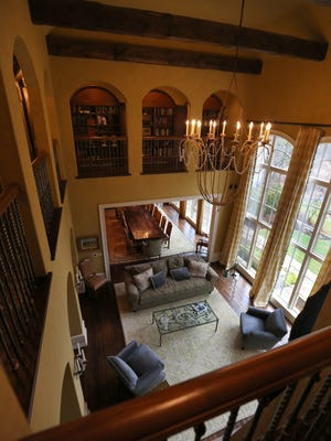 Here's a view of the living room from the second level -- accented by arches all around.