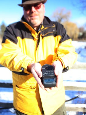 John Anderson, director of park operations at the Detroit Zoo, shows what the sound meter looks like that the zoo uses to monitor their sound levels during busy times.