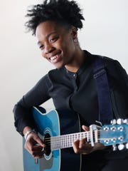 Ambrea Paris performs Keith Laurin's song at the Detroit Free Press on Friday.