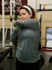 Melissa Demorest LeDuc, 34, due on September 16, works out earlier this month at Real Detroit Muscle in Troy.