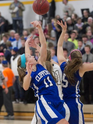 Clear Creek Amana's Kelsey Hall (11) goes up for a rebound during the Clippers' game at Mid-Prairie on Monday, Feb. 9, 2015. David Scrivner / Iowa City Press-Citizen