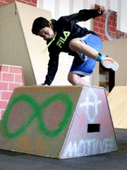 Marco Peralta, 12, of Corvallis leaps over an obstacle during a parkour class at Parkour Infinity.