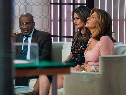 """Co-anchors Al Roker, from left, Savannah Guthrie and Hoda Kotb sit on the set of the of the """"Today"""" show Wednesday, Nov. 29, 2017, in New York, after NBC News fired host Matt Lauer. NBC News announced Wednesday, Nov. 29, 2017, that Lauer was fired for """"inappropriate sexual behavior."""""""