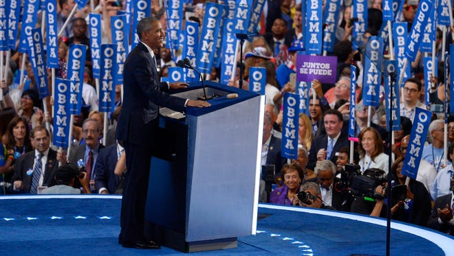 President Barack Obama smiles as he steps to the podium during the third day of the Democratic National Convention in Philadelphia.