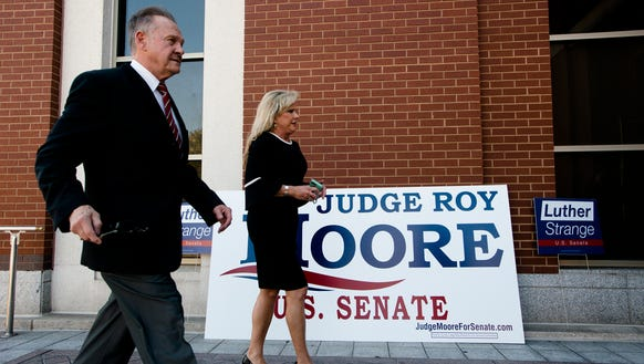 Roy Moore walks into the RSA Activities Center for