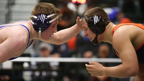 New Rochelle's Jake Logan, left, defeats Horace Greeley's