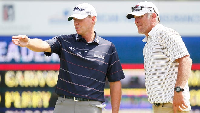 Steve Stricker and Breet Favre at the 11th green during the second round of the inaugural PGA American Family Insurance Championship at University Ridge Golf Course in Madison, Wisconsin on Saturday, June 25, 2016.