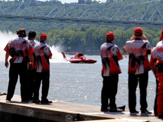 Crew members watch their boat, the U-1 Graham Trucking during practice for the Madison Regatta. July 5, 2014