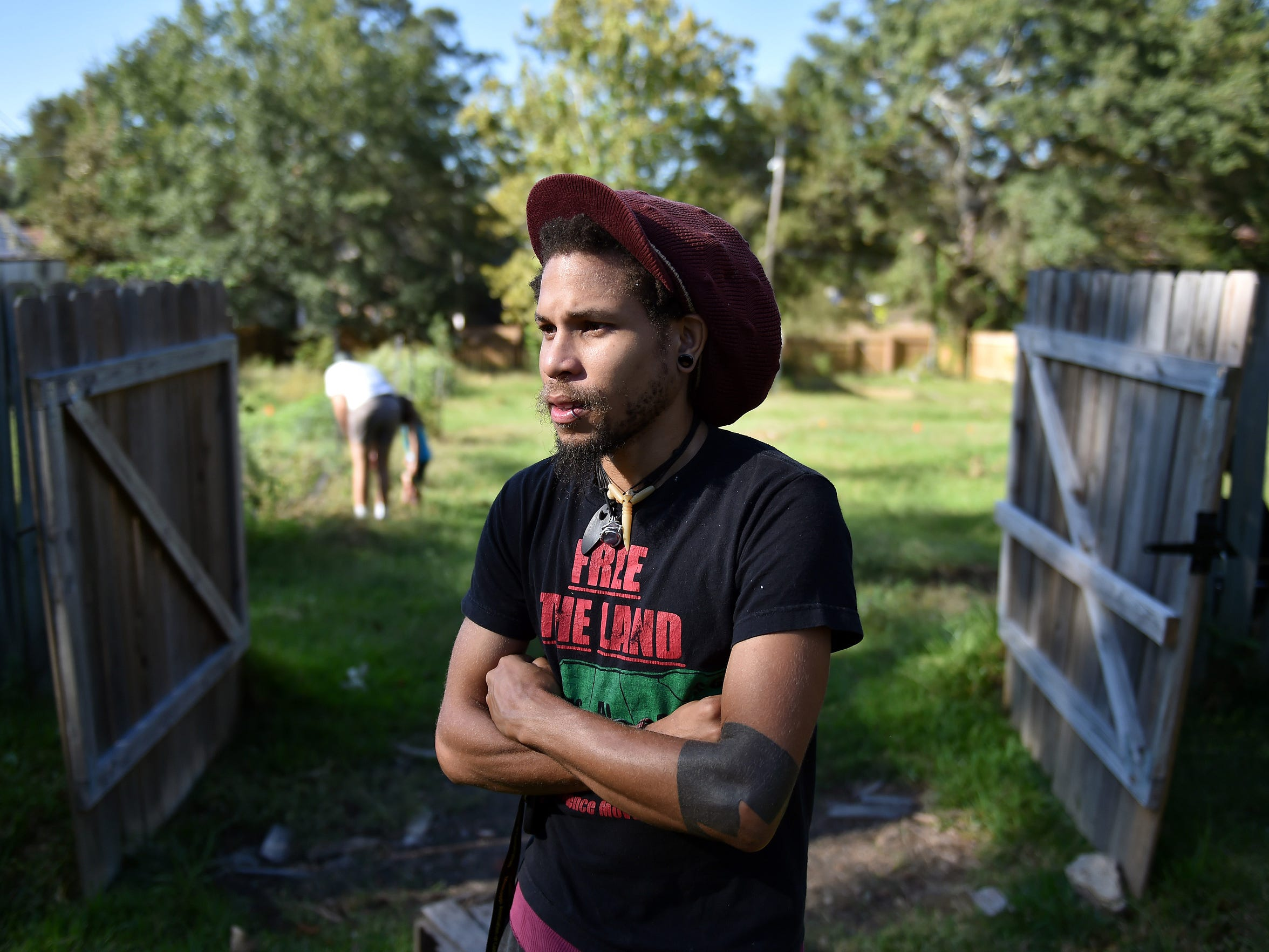 Jackson resident brandon king, who spells his name in all lowercase letters, stands in a garden behind Cooperation Jackson on Oct. 4, 2017, in Jackson.