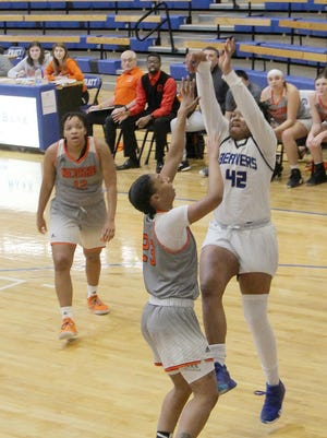 Pratt Community College Lady Beavers' Tytiana Haamid shoots over a Neosho County Community College Panther in the opening round of play in the Region VI Tournament at PCC. The Panthers were hot from 3-point land and took an 84-64 victory over the Beavers to end their season.