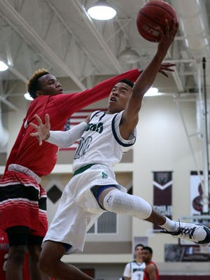 Chino Hills' Cameron Shelton goes for the basket as Jonesboro's Jamari Smith tries to block during the second period on Tuesday during the MaxPreps Holiday Classic Open Division semifinals on Tuesday at Rancho Mirage High School.