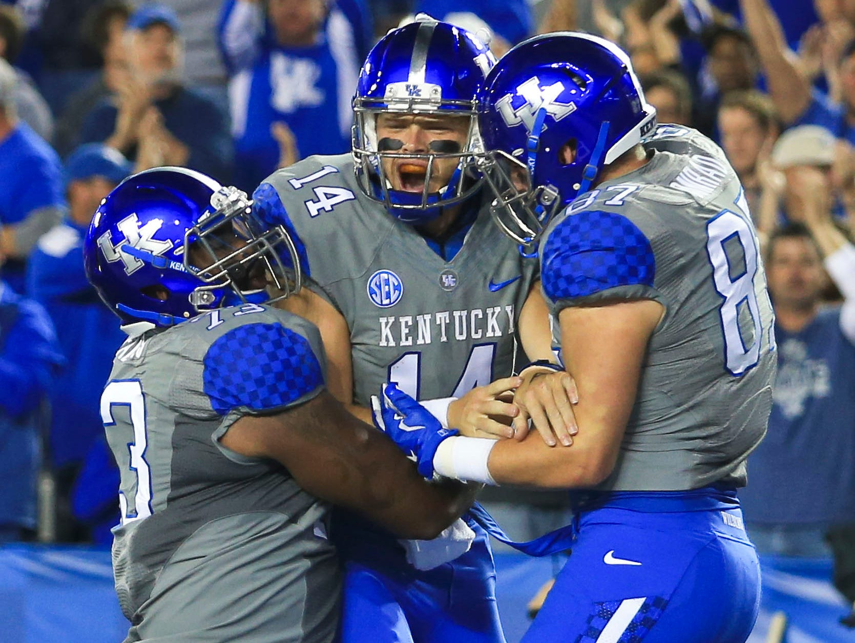 Patrick Towles celebrates his touchdown with teammates C.J Conrad and Kyle Meadows after scoring against Missouri in the first half. Sept. 26, 2015