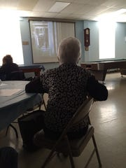 A member of the Bridgewater Senior Citizens watches