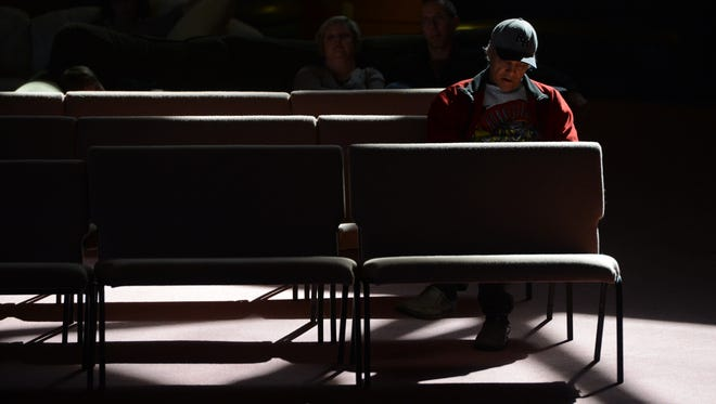 Sunbeams shine on Bill Elrod's shoulders during a recent 11 a.m. Sunday service at Ojai Valley Community Church. The sanctuary and grounds are being sold, with proceeds going to pay rent and to help those in need.