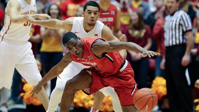 Texas Tech guard Randy Onwuasor is defended by Iowa State's Naz Long during the Cyclones' 75-38 win over the Red Raiders. Iowa State held Texas Tech to just 30.9 percent shooting from the field.