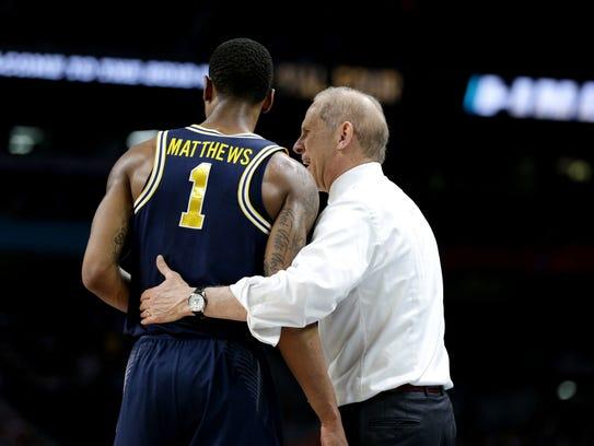 Michigan coach John Beilein instructs Charles Matthews