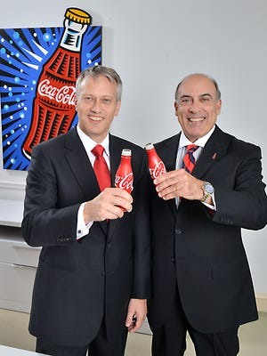 James Quincey, President and Chief Operating Officer of The Coca-Cola Company, at left, will succeed current CEO Muhtar Kent, at right, as CEO, effective May 1, 2017.