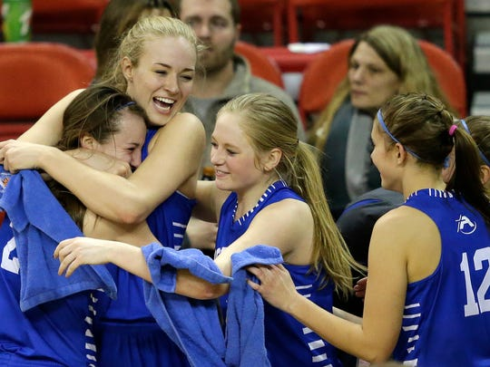 Assumption players celebrate their victory against South Shore during their WIAA Division 5 semifinal basketball game at the Resch Center in Ashwaubenon.