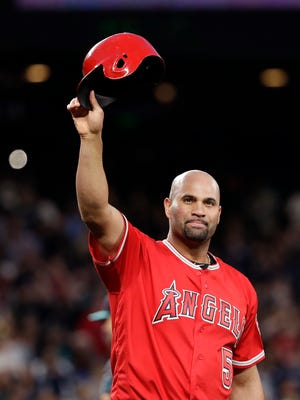 Albert Pujols acknowledges the crowd after hitting a single for his 3,000th career hit on Friday night in Seattle. (Elaine Thompson/AP)