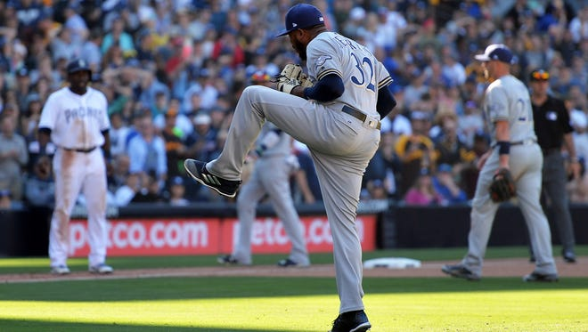 Brewers relief pitcher Jeremy Jeffress celebrates after the end of the 11th inning against the Padres on Thursday at Petco Park.