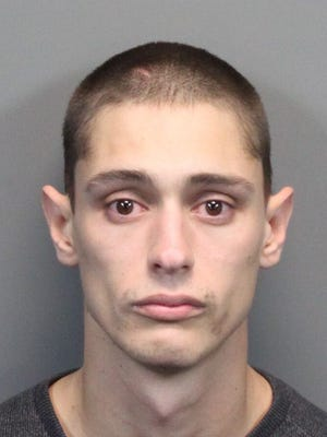 Stephen Christie, 27, was booked Monday into the Washoe County jail on several charges including armed robbery, eluding police and an ex-felon in possession of a firearm. Christie was arrested after a police car chase during an investigation into a string of car thefts and store robberies in Reno.