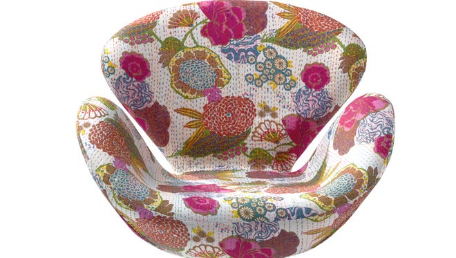 A contemporary bucket chair with a vibrant floral print, from HomeGoods, that brings upbeat summer style to a variety of spaces.