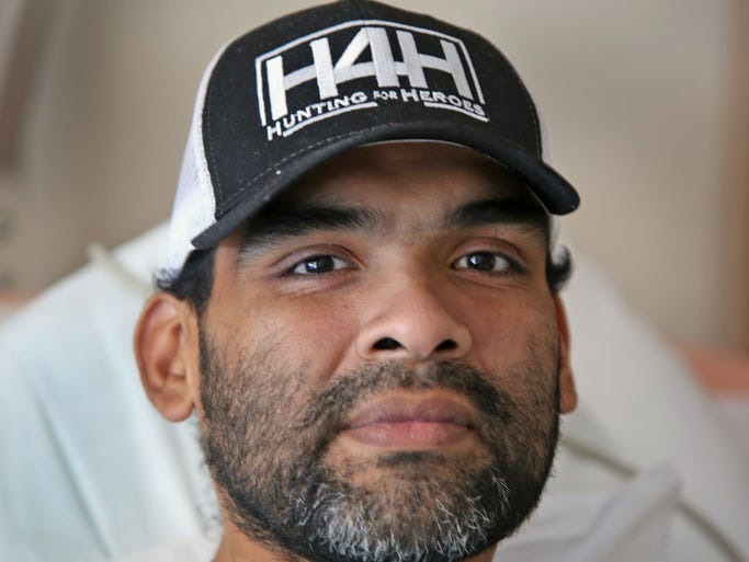 Santos Cortez lies in his room at Kindred Hospital - Indianapolis South in Greenwood, on Aug. 20, 2014.  The IMPD officer was paralyzed when his cruiser was hit by a drunk driver on June 11, 2012.  He has been in and out of the hospital ever since.