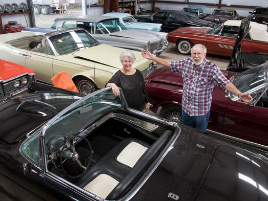 Cal and Norrine Gray pose among the classic cars at