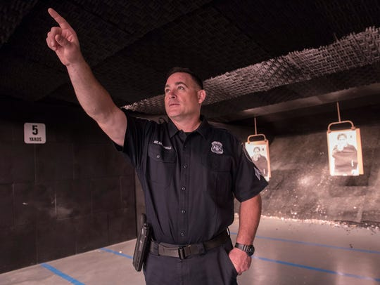 Sgt Brian Bastianelli points out the location of the