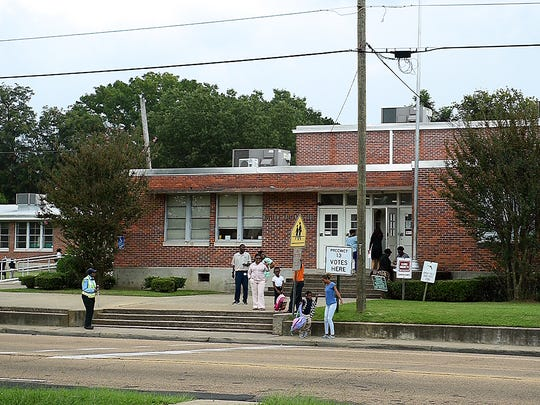 In this file photo, students wait to be picked up outside Walton Elementary School. The school is one of more than 50 campuses slated for renovations if a $65 million bond issue passes Tuesday.